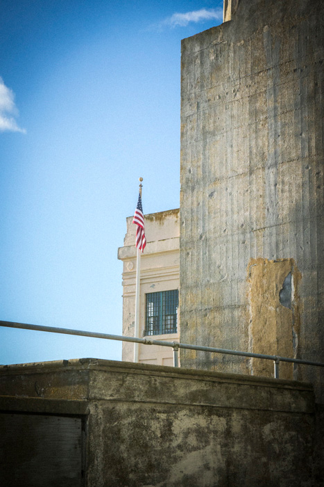 Flag in front of the administration building of Alcatraz penitentiary, off the coast of San Francisco, USA