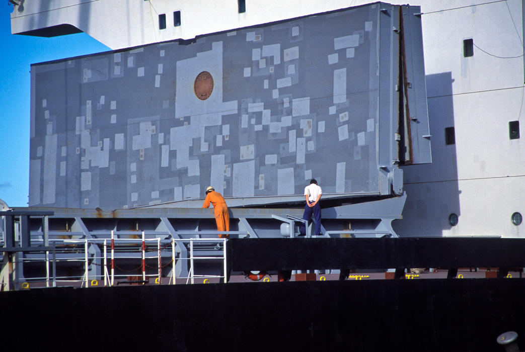 Inspecting the cargo hold of a freight ship at Port Kembla dock