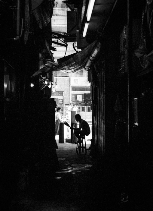 Whilst in Kowloon, Hong Kong I saw this man casually reading a newspaper at the end of a narrow path between two buildings. It made for a nice silhouette.