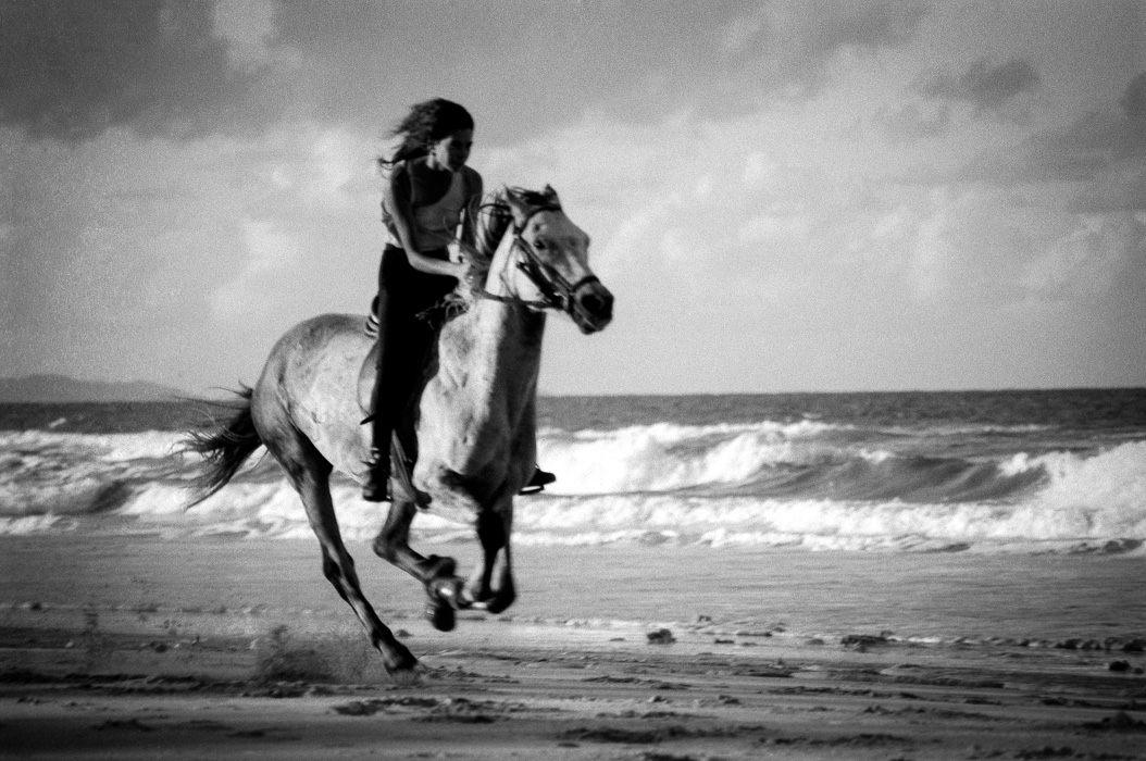 Liz Galloping her horse on Belongil Beach, North of Byron Bay.