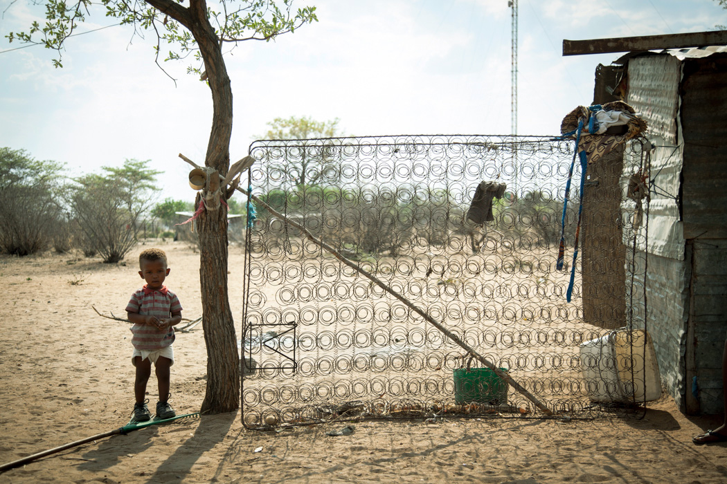I am not really sure what the mattress frame at the side of this little boy's home was for. In Africa you see some really cleaver and original uses of everyday things that may have been discarded by somebody else.