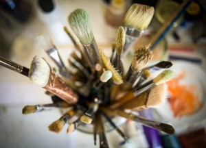 A collection of artist's brushes from above.