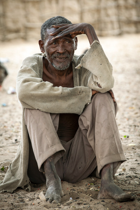 This man always stayed outside the main group in his village in the Okavango Region, Namibia-Boswana border, watching everything that was going on.