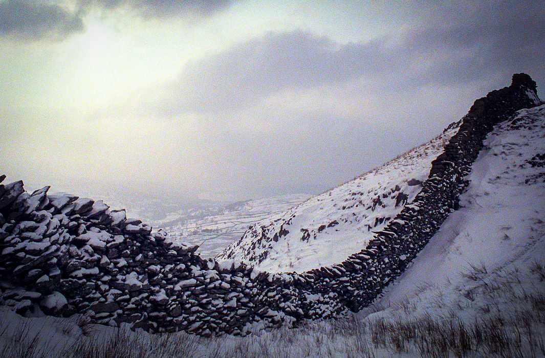 Dry stone wall in the snow of Cumbria's Lake District in Northern England.