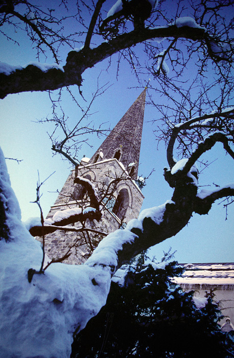 Spire of Le Chable Parish Church in the Swiss Alps, constructed in 1488.