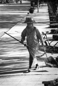 Woman sweeping the streets of Koh Samui, Thailand, 1985
