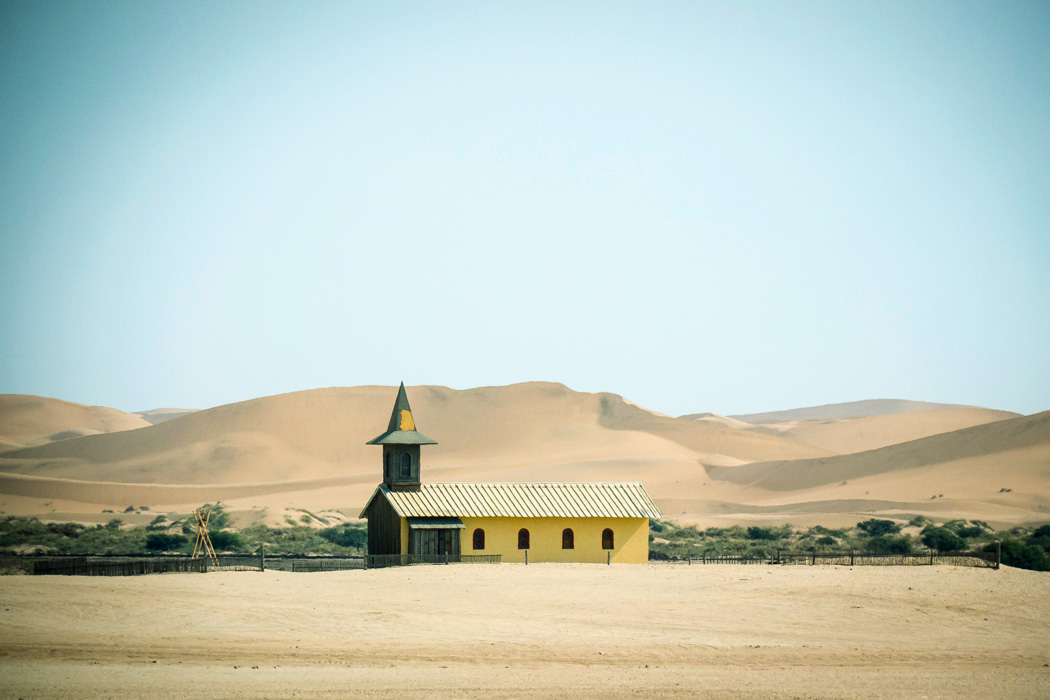 Church set against the dunes of the Namib desert, near Walvis Bay, South-West Namibia