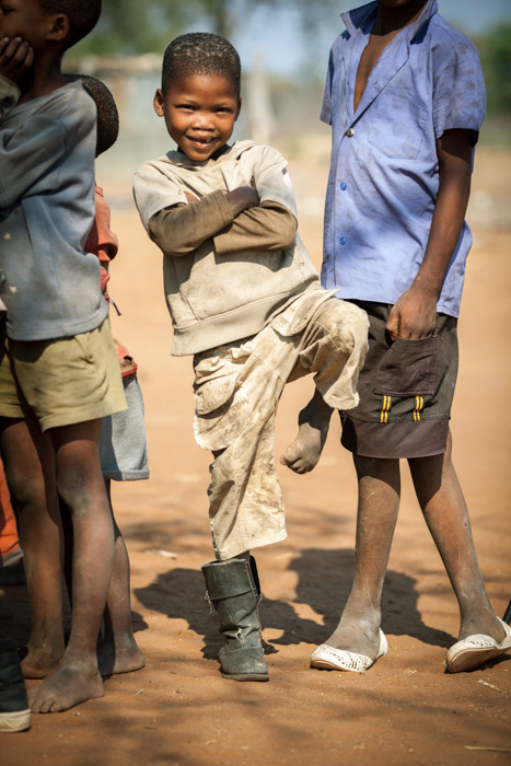 One Boot. An unusual way to get the photographer's attention. He had the other boot, just not when he wanted me to take his picture. Hai//com Village, Kalahari Desert, Namibia.