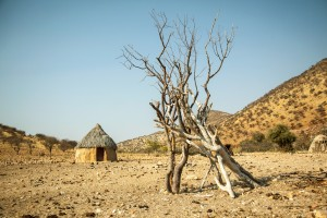Hut in a small ovahimba village near Opupa Falls, North-Western Namibia