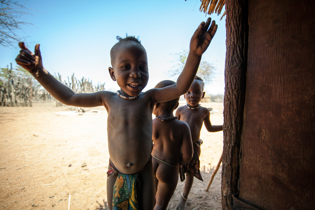 Ovahimba kids at the doorway of a hut, Namibia
